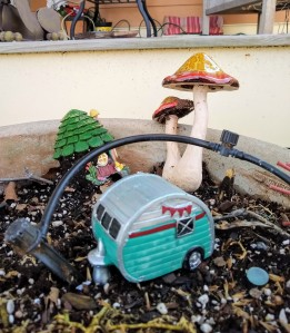 Tiny camper in a fairy garden