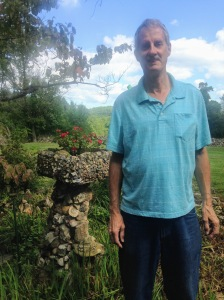 Dan at Quigley Castle with rock planter  and view of the land.