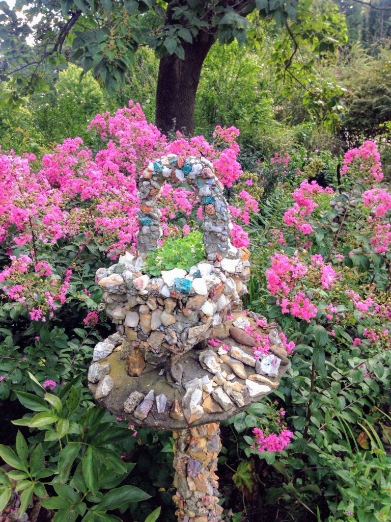 Planter made from rocks in the shape of a basket.