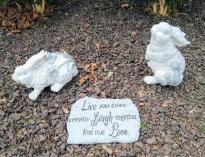"Two bunnies on mulch with plaque that says, ""Live your dream.  Everyday Laugh together.  Find true Love."""