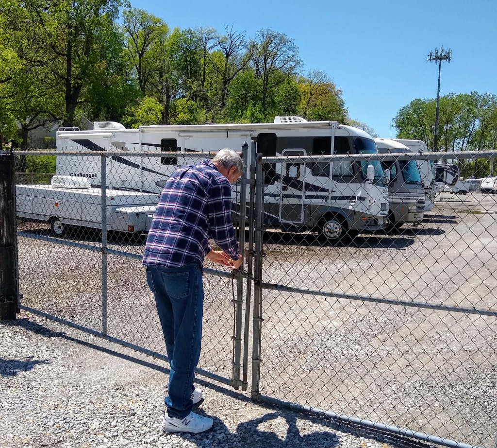 Dan locking the gate at the RV storage place.