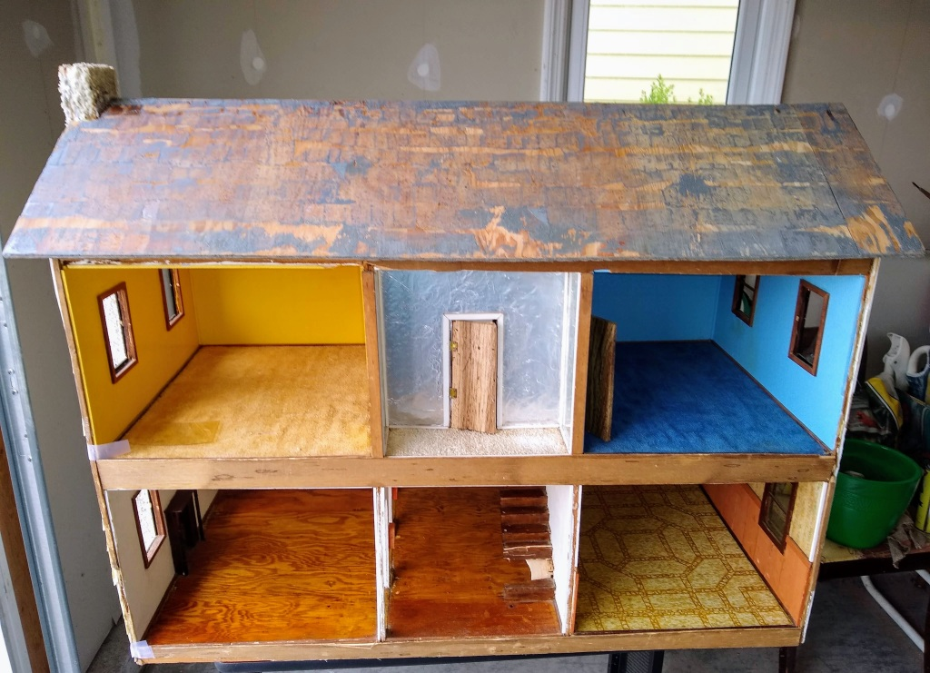 Dollhouse.  No furniture.  Roof shingles removed.  Chimney back on.