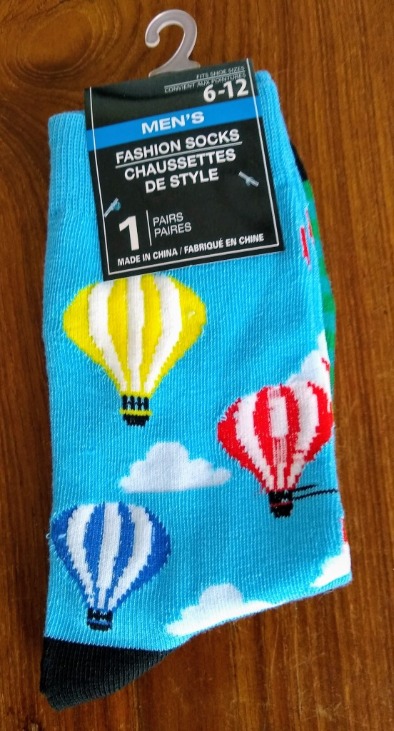Socks with hot air balloons on them.