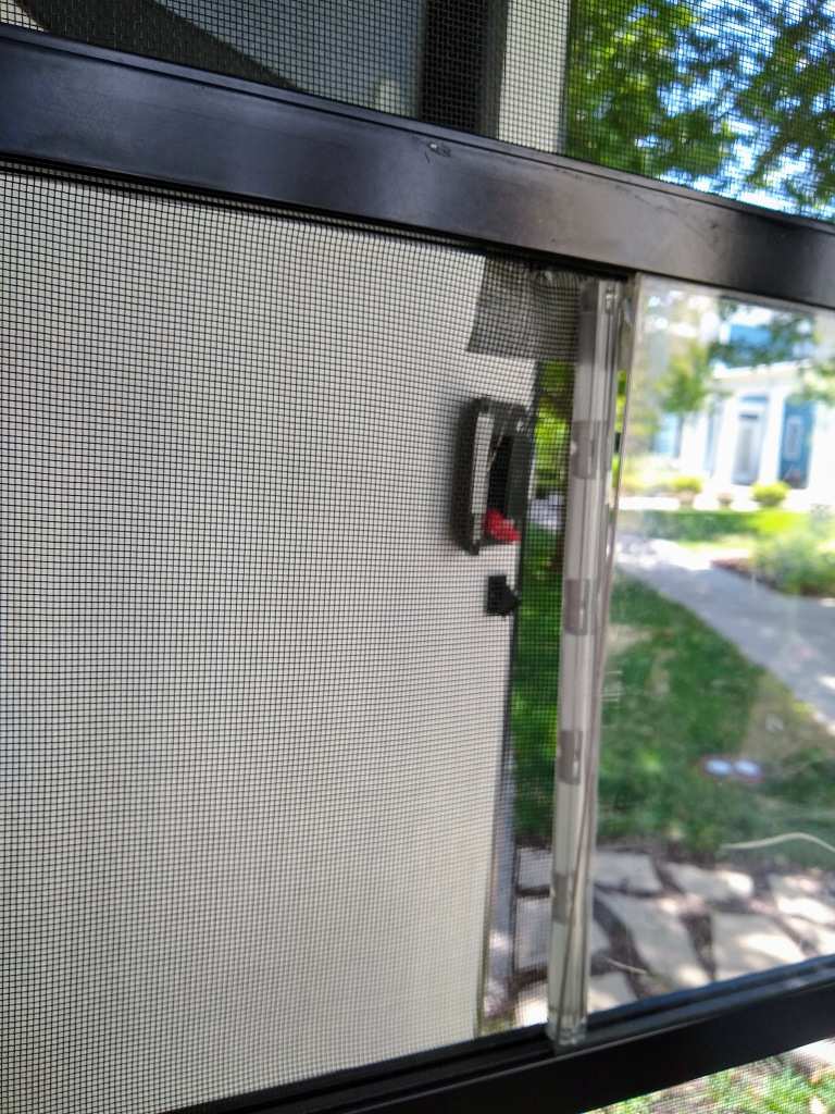 View of broken screen door in travel trailer.