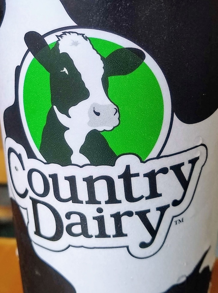 "Cow picture with ""Country Dairy""."