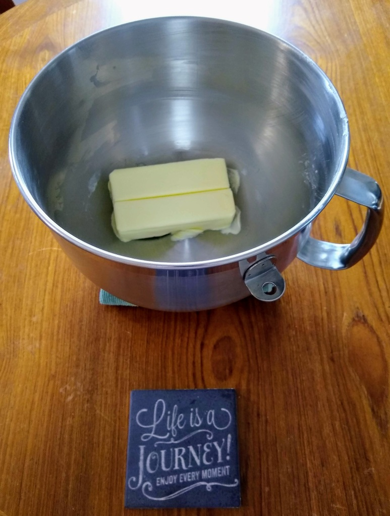 Bowl with 2 sticks of butter melting.