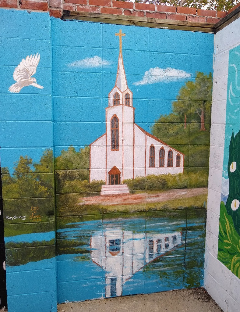Mural of church and its reflection in water below.