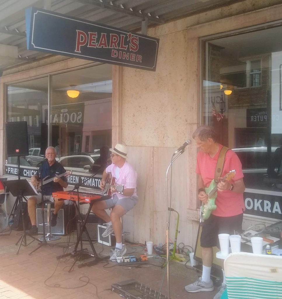 Band playing outside Pearl's diner.