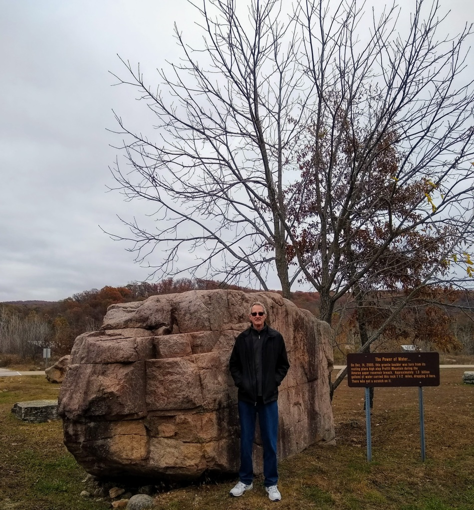 Picture of Dan by large boulder.