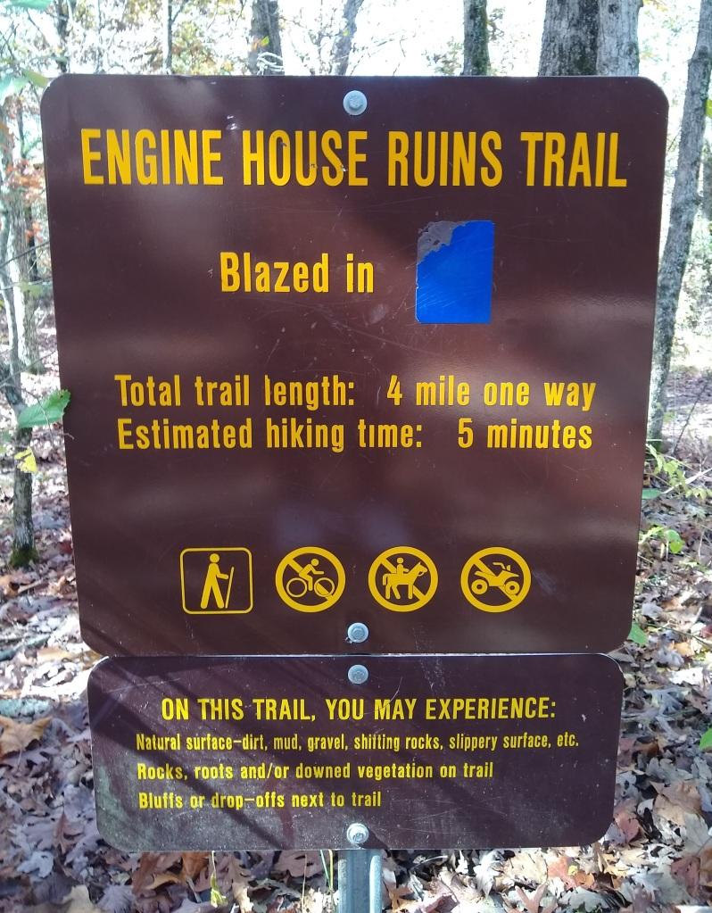 Trail sign.  Total trail length: 4 mile one way. Estimated hiking time:  5 minutes.