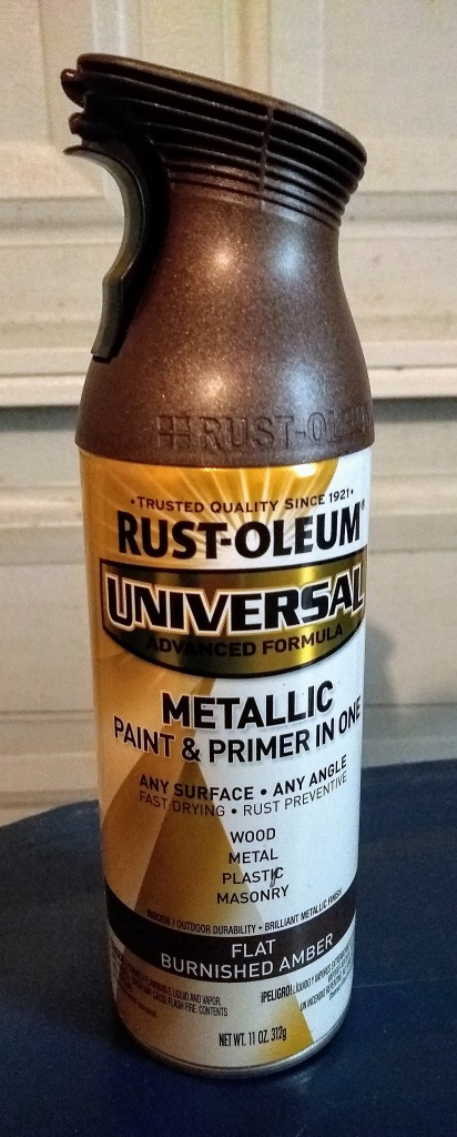 Spray paint.  Rust-Oleum.  Metallic paint and primter.  Flat Burnished Amber.
