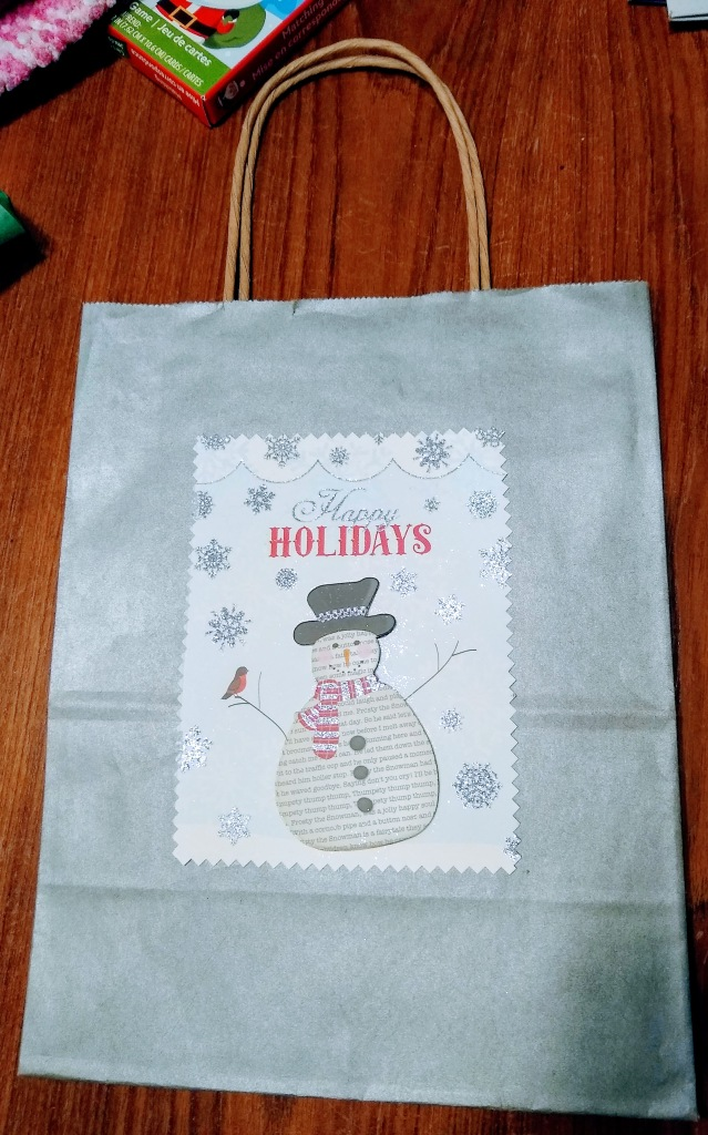 Gift bag with picture of snowman on it