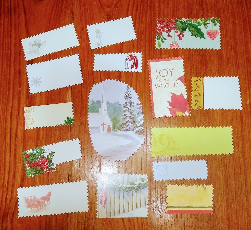 Gift tags made from Christmas cards cut with pinking shears