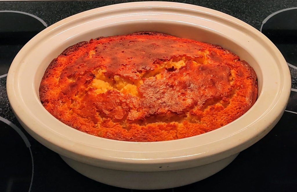Casserole dish with sweet corn casserole baked in it