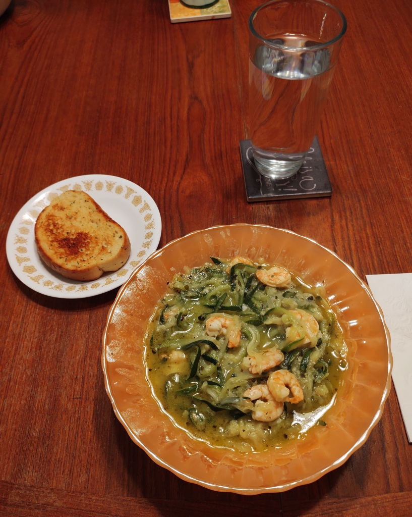 Shrimp scampi with zoodles and garlic toast.