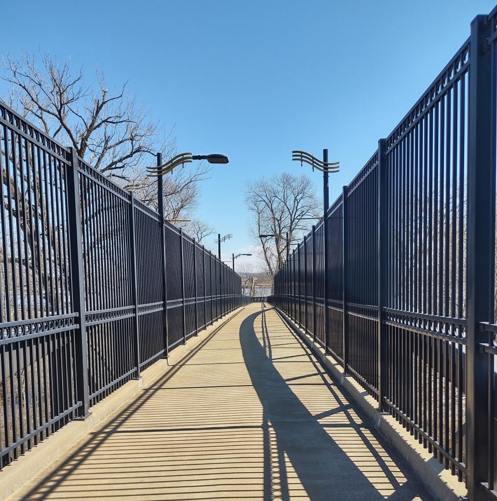 Bridge with shadows on walking trail.