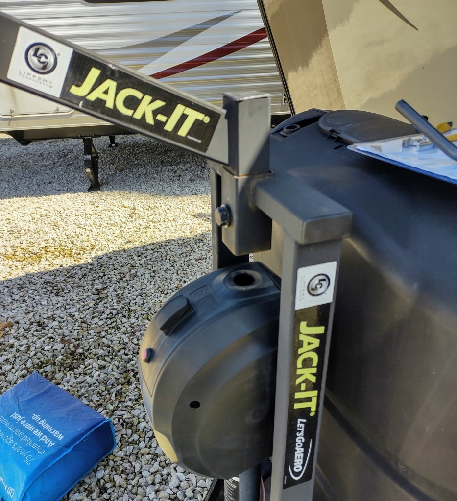 Close up of Jack-It bike rack over the automatic RV jack.