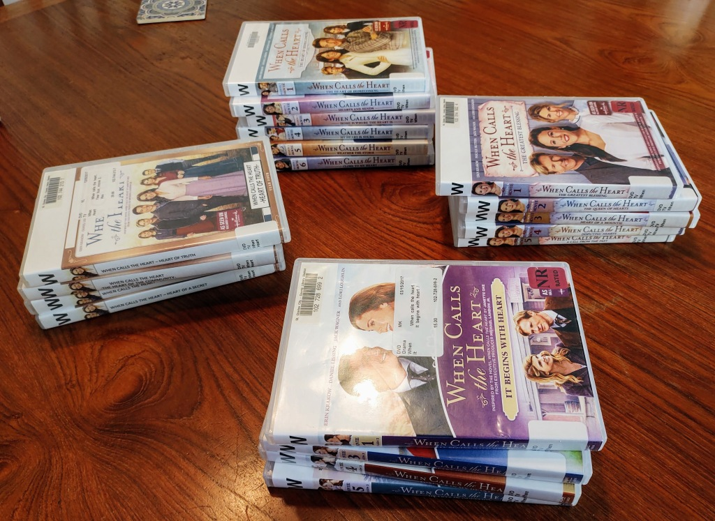 """Four stacks of """"When Calls the Heart"""" DVDs."""
