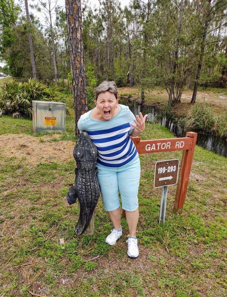 Betty posing as if an alligator bit off her arm.