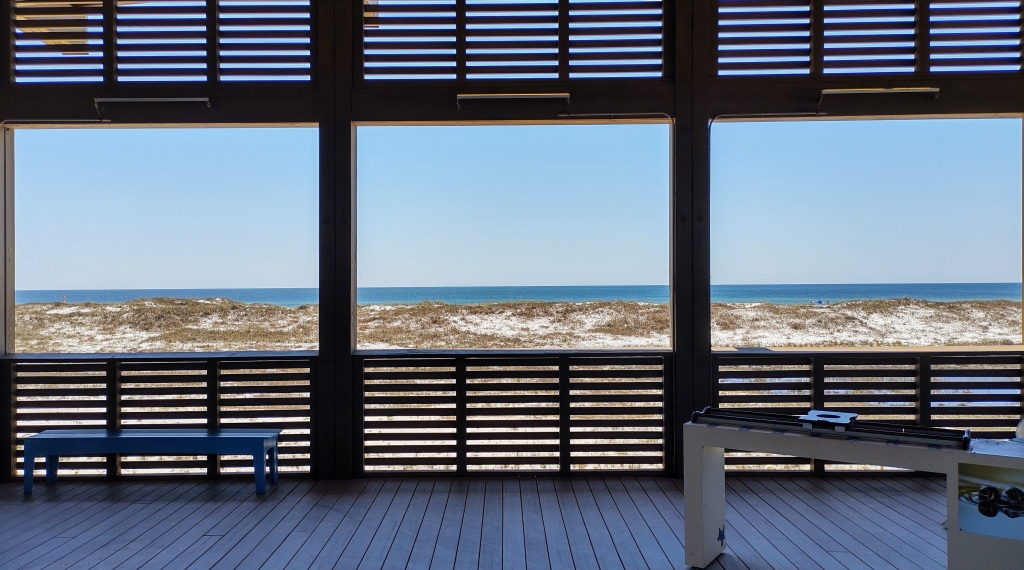 View from inside the outdoor Interpretive Center with beach and ocean in the background.