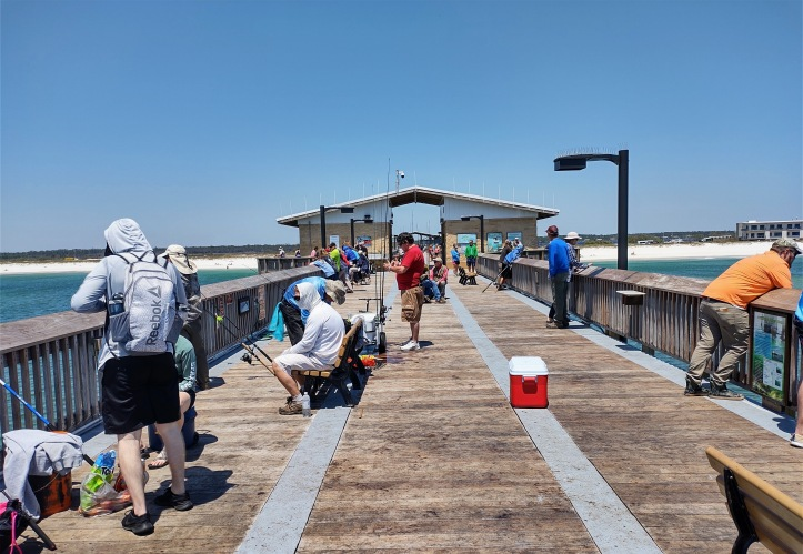 The Pier with a number of people fishing.