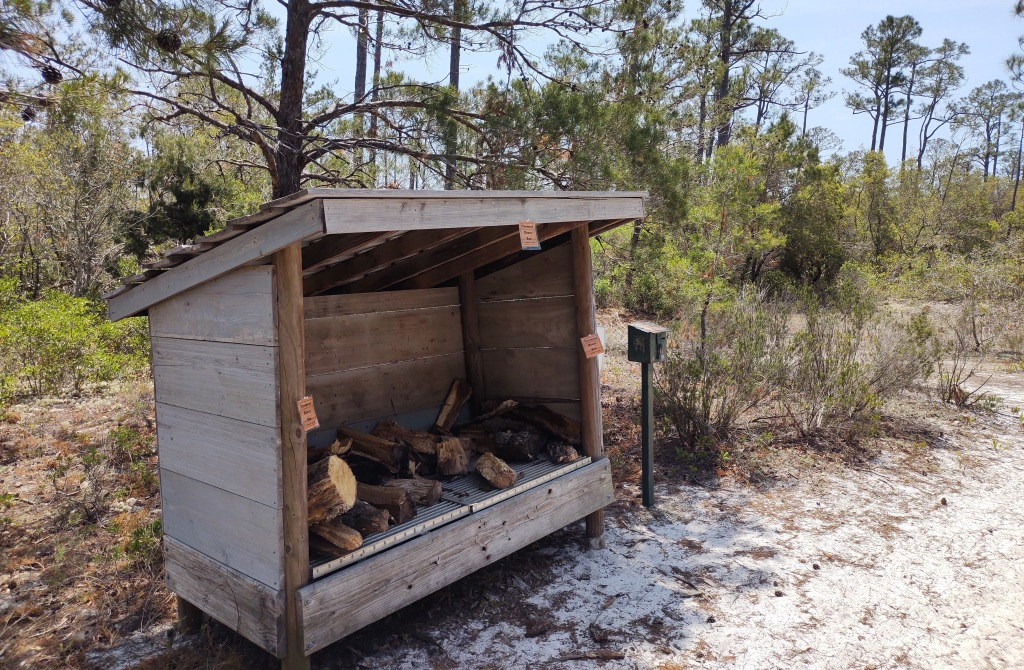 Shed with firewood and payment box.