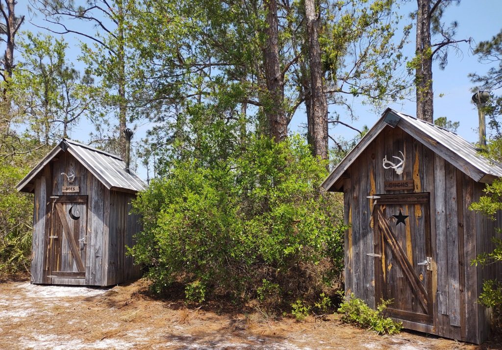 Two outhouses.