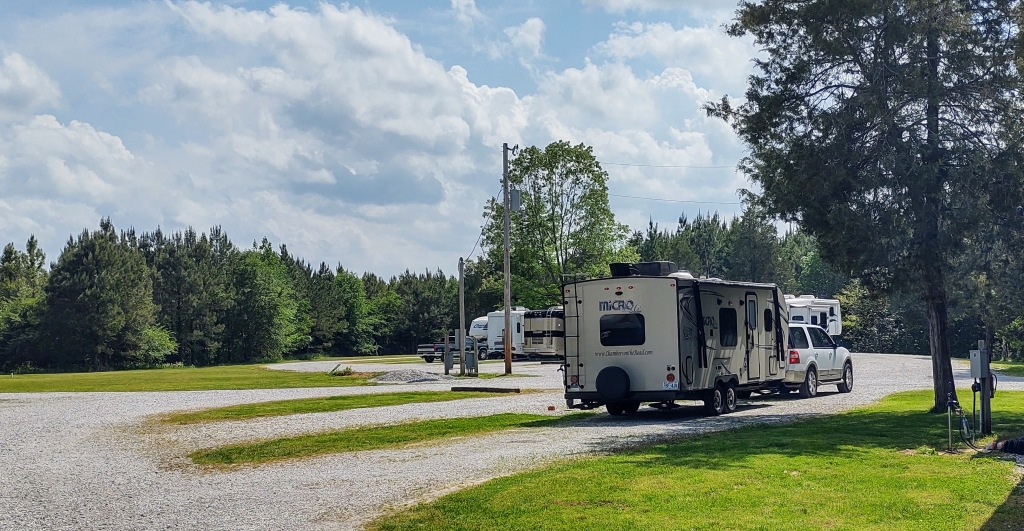 View of back of Micro Lite travel trailer and Ford Expedition.