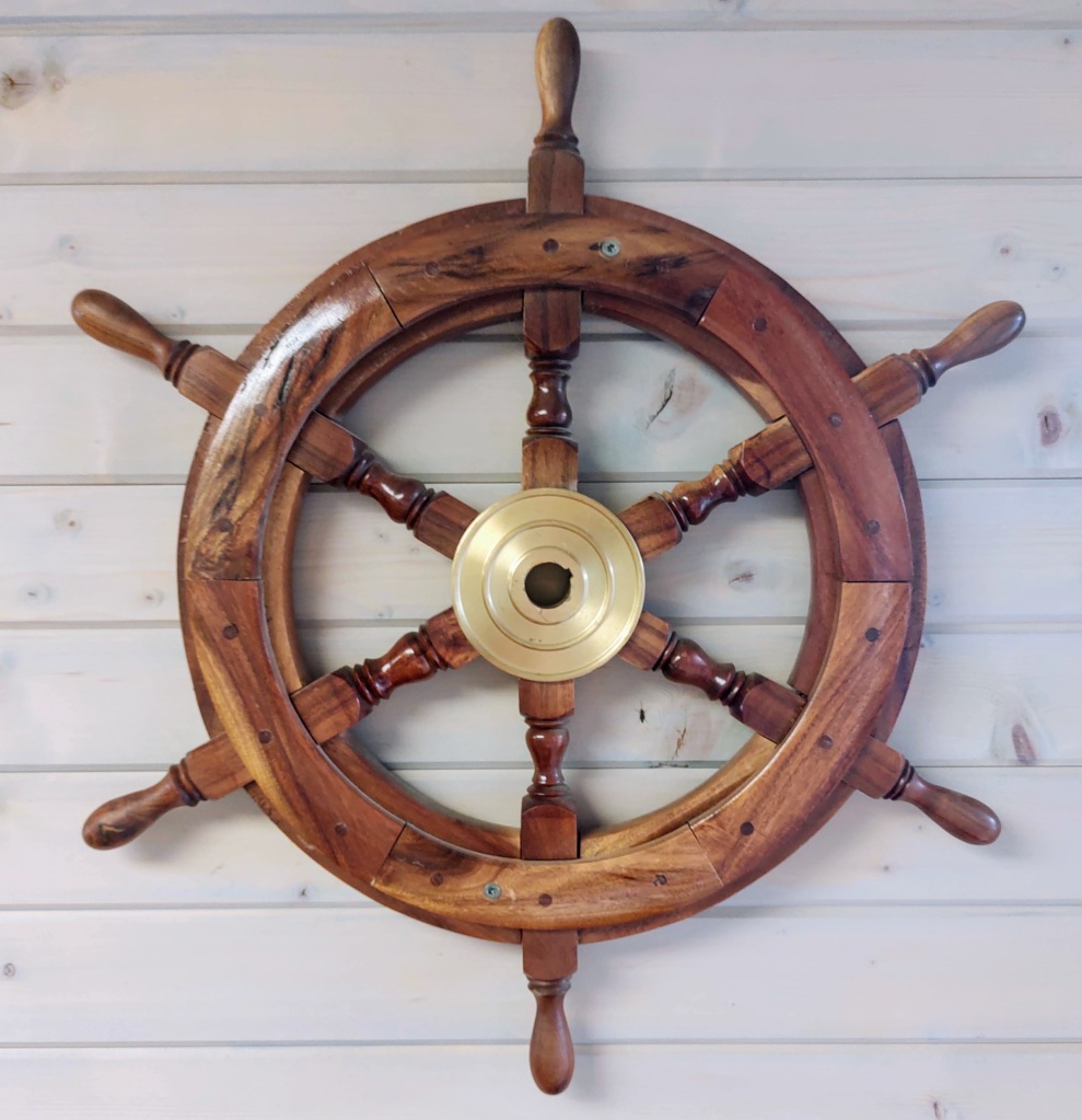 Steering wheel of a river boat.
