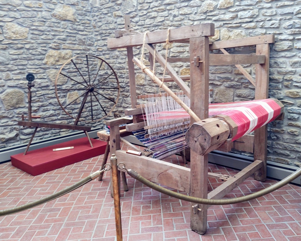 Spinning wheel and loom.
