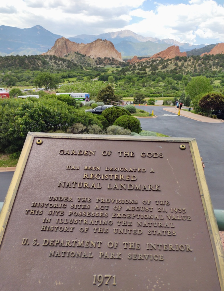 Garden of the Gods plaque with view in background.
