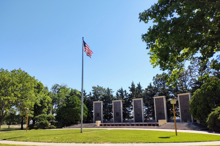 View of five pylons with United States flag in front.