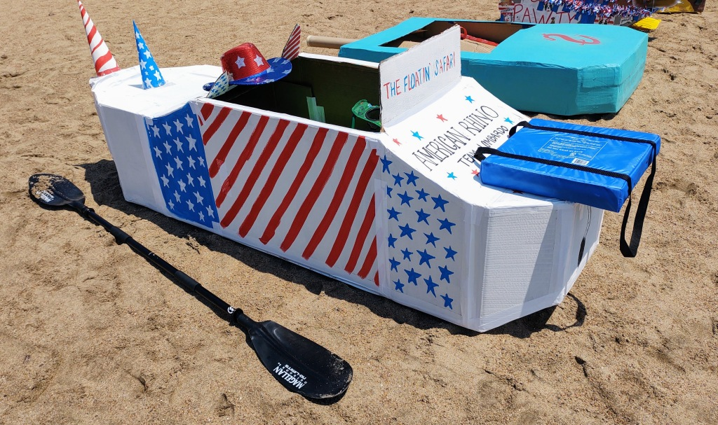 Cardboard boat decorated with red,white and blue.