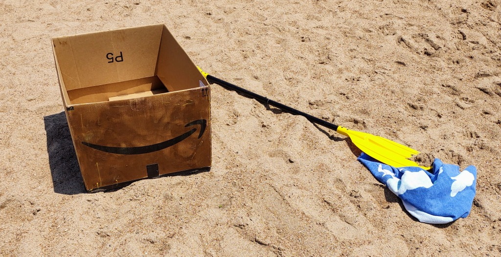 Amazon box with a paddle.