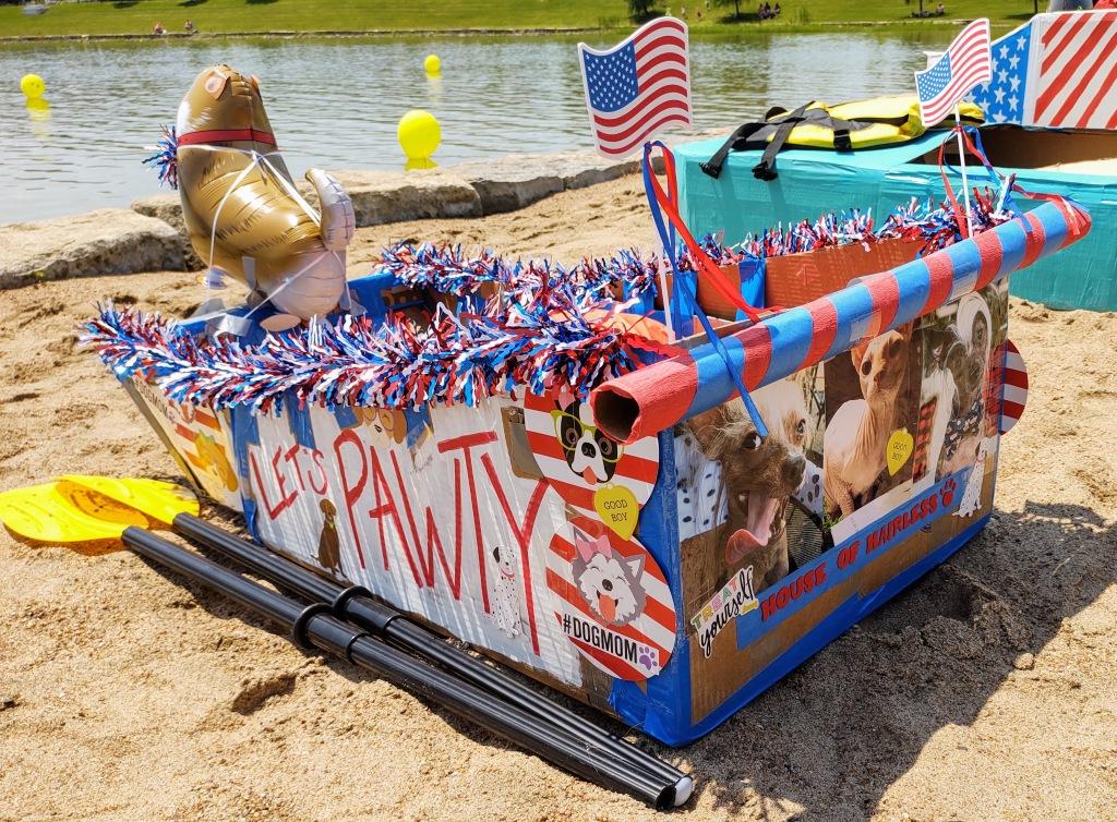 Dog theme cardboard boat.  Let's Pawty!