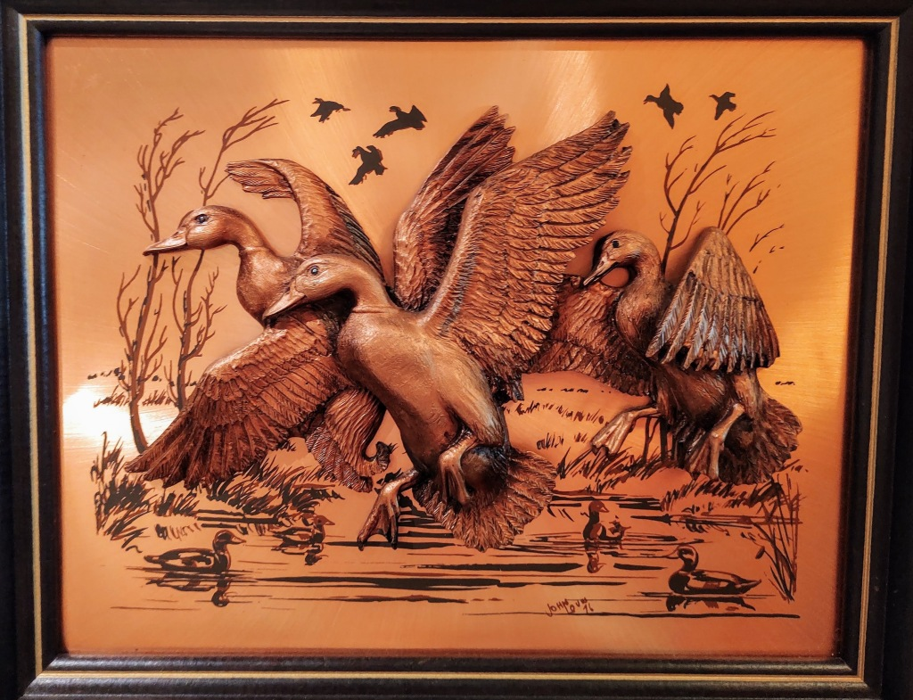 Copper picture of geese.