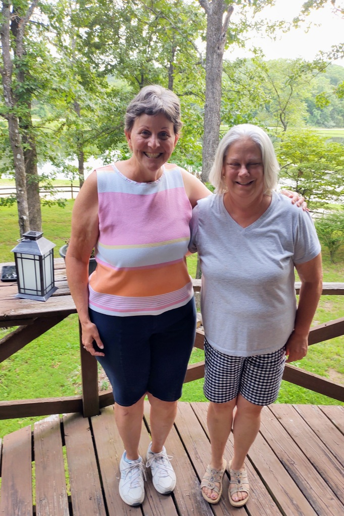 Betty and Karen standing on the deck.