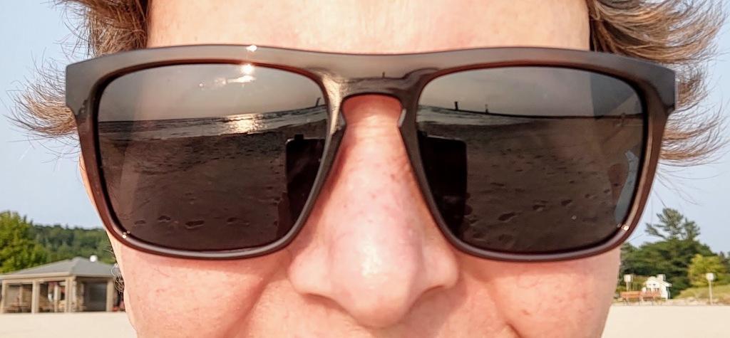 Sunglasses reflecting Lake Michigan.