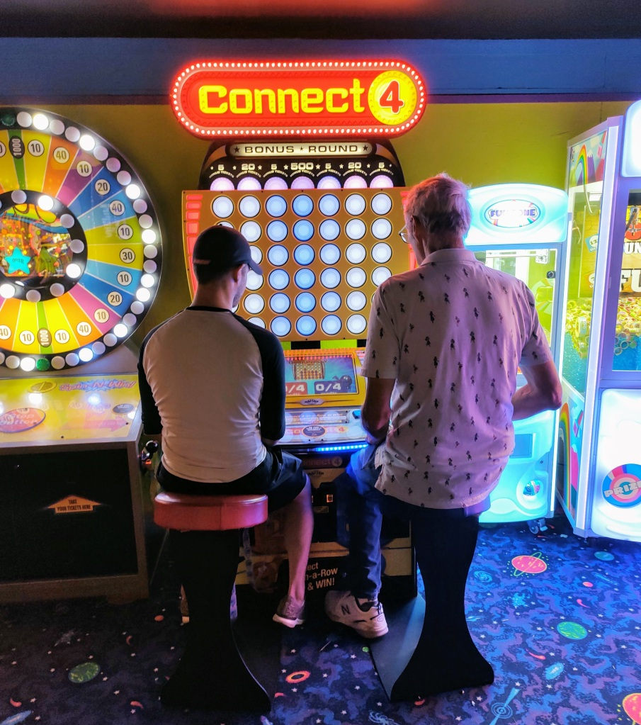 """Danny and Dan playing """"Connect Four"""" at the AJ's Arcade."""