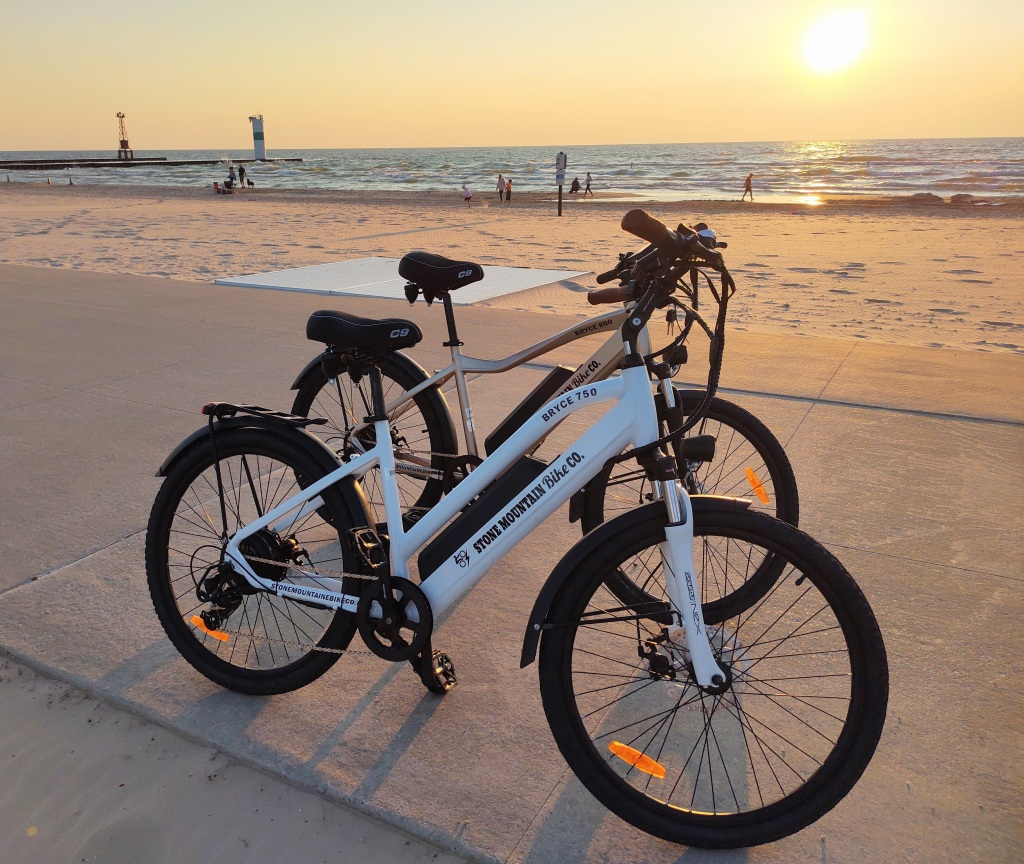 Two e-bikes with Lake Michigan in the background.