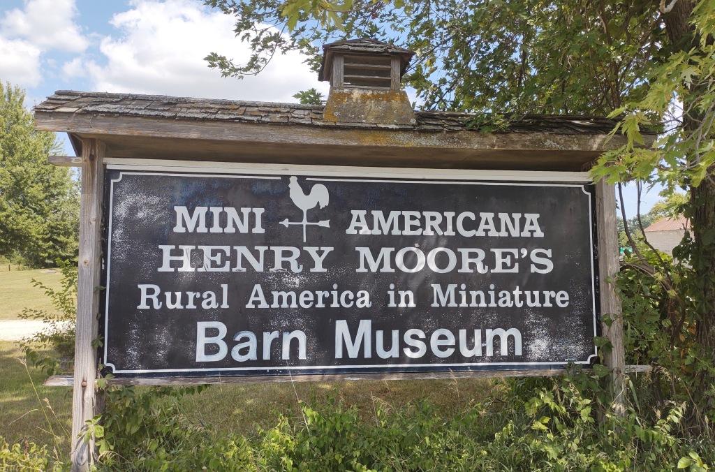 Sign for Mini Americana Henry Moore's Rural America in Miniature  Barn Museum.