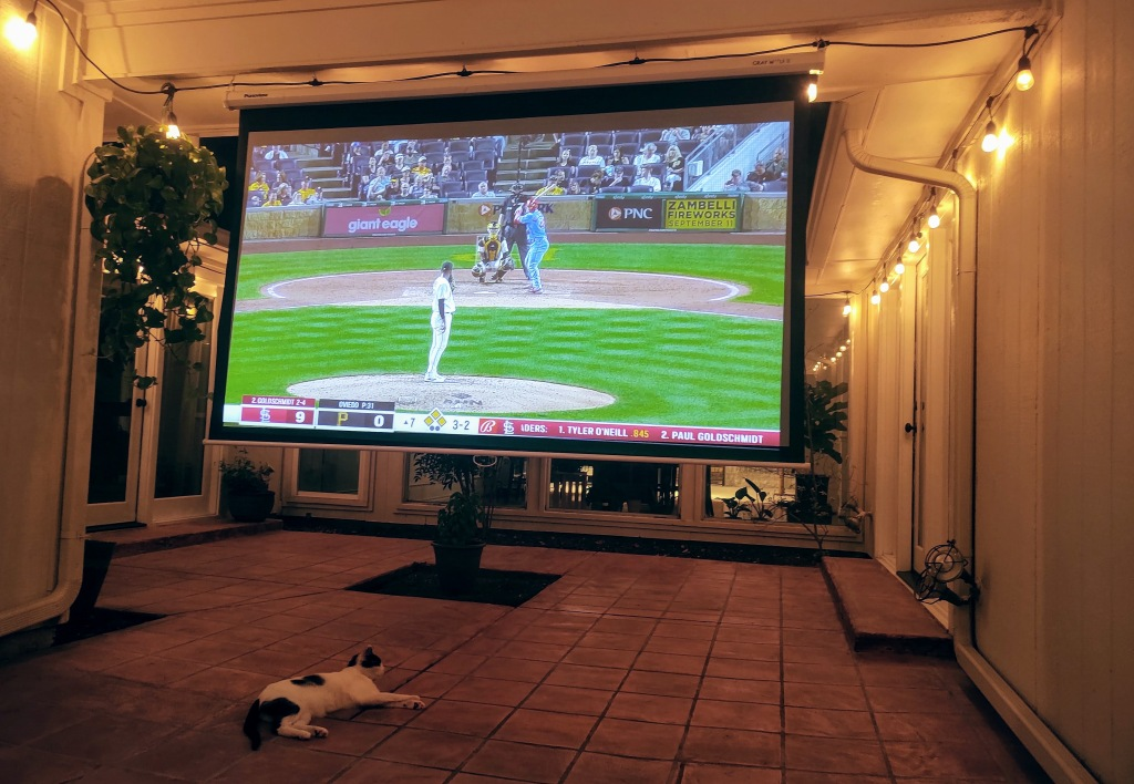Huge screen with Cardinal game projected on it.