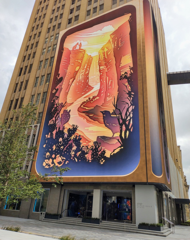 Colorful picture on big screen on big building.