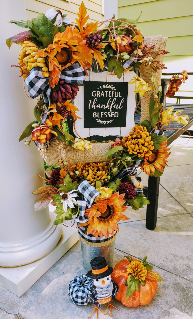 """Fall porch decoration with words """"Grateful, Thankful and Blessed."""""""