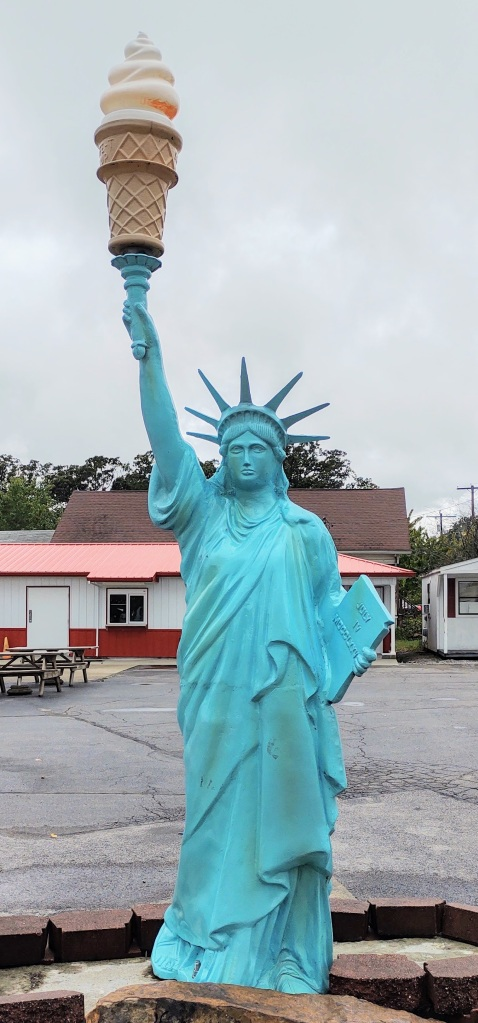 Statue of Liberty holding an ice cream cone.