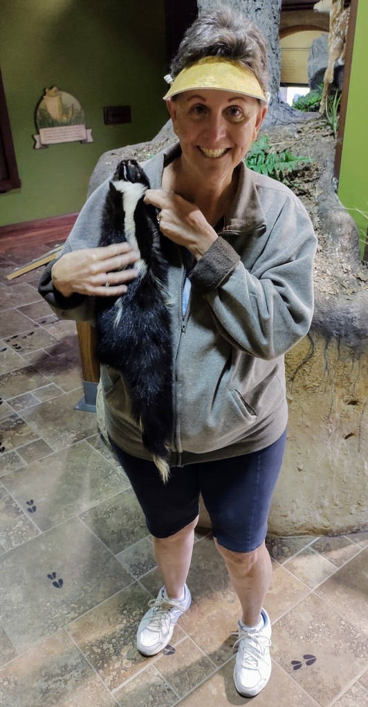 Betty holding a skunk.  It's really just the skunk's skin in a nature museum.