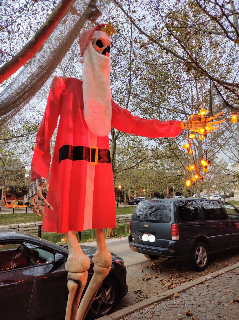 Large Halloween decoration - a large skeleton in a Santa outfit.